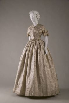Wedding dress and separate bodice, 1854. Silk jacquard, satin, net. No label. Worn by Sarah Seymour when she married William Blair on June 21, 1854.
