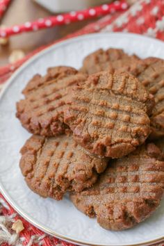 Quick, easy and delicious 3 Ingredient Peanut Butter Cookies. They take just minutes to throw together and are so easy the kids can make them!