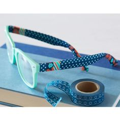 Jazz up your sunglasses with colorful washi tape accents.