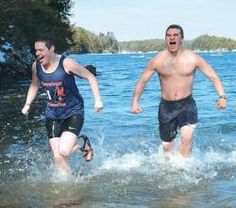 """A """"POLAR BEAR"""" LEAP into icy water kicks off spring, held at the boat launch off campus due to a frozen solid waterfront on campus this winter. Pictured are semester school math teacher Lilly Betke-Brunswick, left, and student Cortland Fischer of Middlebury Union High School."""