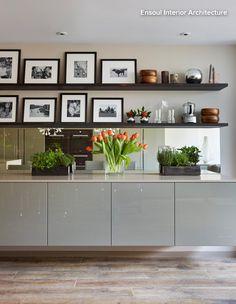 Kitchen units raised off the floor; mirrored splashback. | Ensoul Interior Architecture via houzz