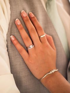 Highlight your engagement ring with a  French manicure and accented ring finger nail. #WeddingNails