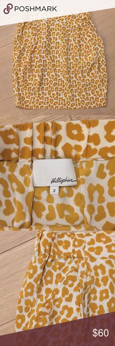 """Phillip Lim mustard cheetah pattern skirt Phillip Lim cheetah patterned skirt. 100% silk. Elastic waistband in back and sides and flat waistband in front. Side slit pockets and darting. Slightly tapered. Hits just above the knees (I'm 5'6"""" and normally wear a size 4/6/28 in jeans and pants). This skirt was cut a little big so a 2 fit me. Color is mustard and white/cream. Comfortable and very versatile. Smoke and pet free home. Purchased at the Phillip Lim boutique in NYC 3.1 Phillip Lim…"""