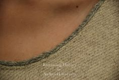 Fingerloop braid along neckline close up