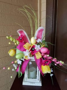 Easter Lantern Swag, Bunny Lantern Swag, Spring Lantern Swag ,Easter Decor, Centerpiece,Lantern Swag, Bunny Decor, Spring Decor, Rabbit Swag This bright and cheery Easter Bunny Lantern Swag will put a smile  on your face. With big bunny ears, yellow tulip, pink poppy, white wild
