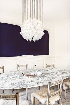 Textures! White marble obsidian dining room