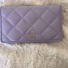 Kate Spade wallet Beautiful lavender wallet. 4 money slots, 7 card slots and a zip on the back for coins. Some wearing on corners and edges, example as pictured in the last photo. I really love this wallet but I'm trying to simplify the amount of things I have.  kate spade Bags Wallets