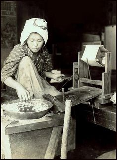 WOODEN GEARS WIND THE RAW SILK STRANDS FROM COCOONS in OLD JAPAN by Okinawa Soba, via Flickr, ca 1915-23.