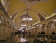 Komsomolskaya station, Moscow Metro, 1952, grand baroque style designed by Dmitry Chechulin with 68 pillars faced with pinkish limestone and blue-grey marble and a gray granite floor.  The ceiling is decorated with eight mosaic panels of smalt and precious stones. The theme represents the Russian fight for freedom and independence.