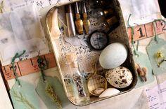 Altoid tin shrine in altered book by Teresa Gifford