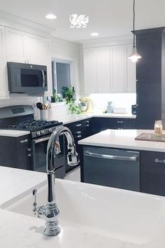 Black cabinets create a sultry foundation in this kitchen and our Torquay™ design tops it off with a polished finish.