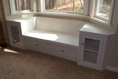 bay window bench with storage...more interesting shape. add bookcases on each side that go all the way to ceiling with crown molding.
