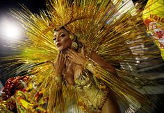 A reveler parades for the Tom Maior samba school during Carnival in Sao Paulo.