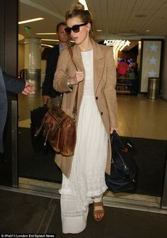 Natural beauty: Amber Heard, 30, managed to look refreshed as she made her way through LAX on Monday