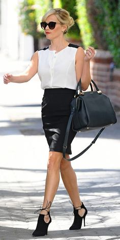 The No-Fuss Office Look That Will Impress Your Boss via @WhoWhatWear On Reese:  Rag & Bone Sleeveless Tail Shirt ($130)  Giambattista Valli skirt  Lanvin Trilogy Bowling Bag ($1990)  Aquazzura Babe Booties ($695) in Black  Similar Style:  Grayse Seam Detail Pencil Skirt ($245)