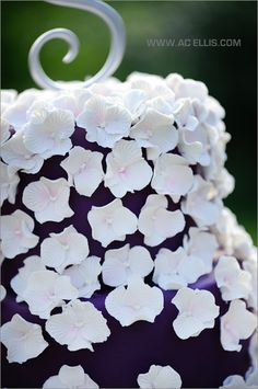 Purple and white wedding cake with delicate flowers - south dakota