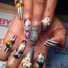If you say Beetlejuice three times, he might appear on your nails! Get your manis ready for Halloween with these spooky nail designs inspired by the Tim Burton movie. Holloween Nails, Halloween Acrylic Nails, Halloween Nail Designs, Funky Nail Art, Funky Nails, Acrylic Nail Designs, Nail Art Designs, Goth Nails, Goth Nail Art