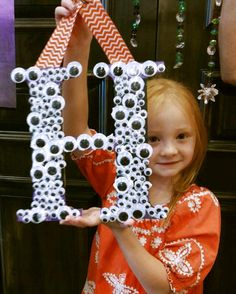 This little cutie made a googley-eyed monogramed letter here at @PinspirationAZ! How cute is this going to look in their house with all of their Halloween decor! <3 #bestofourvalley #fallbreak #fallbreakcamp #phoenix #scottsdale #camp #thingstodo #halloween #halloweendecor #diy #makers #pinterest #craft #artstudio #daycamp #decor #holidays #littlemakers #craftingisforeveryone #monogram #monogramletter