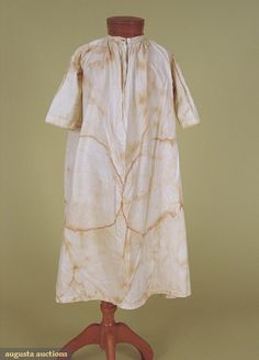 19th Century Child's Nightgown  Band collar with china button, three quarter sleeves edged in crochet zig-zag lace, all hand sewn.