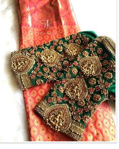 Gorgeous bottle green color designer blouse with hand embroidery bead and lakshmi motif work on sleeves and neckline. Cutwork Blouse Designs, Wedding Saree Blouse Designs, Pattu Saree Blouse Designs, Fancy Blouse Designs, Hand Work Blouse Design, Stylish Blouse Design, Traditional Blouse Designs, Couture, Cut Work