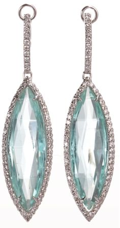 Two faceted marquis-shaped mint tourmalines with double-face white diamond pave surround.  via Diamonds in the Library