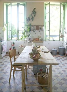 love the green trim on the window - a nice splash of colour against the white and with all the sunlight - so pretty.