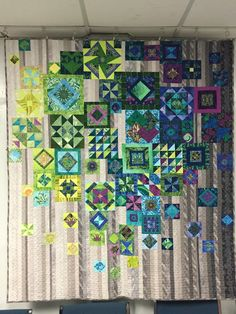 an interesting take on the Gypsy Wife quilt pattern: limited palette of mostly cool colors, over vertical background stripes all in neutrals   quilted by Dianne Jansson via Knit and Knag   pattern by Jen Kingwell