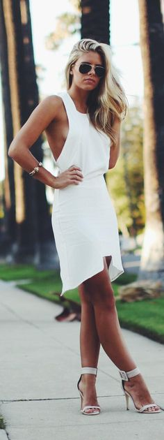 gorgeous white - Pretty white sleeveless mini dress with inverted hemline...perfect for summer!