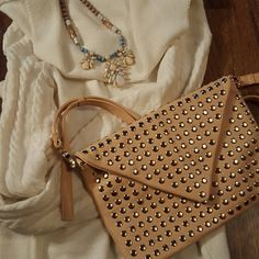 Beige studded bag This bag is new and never used! In perfect condition. The strap in the bag is removable and comes with the dust bag. JustFab Bags Crossbody Bags