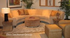 A curved sectional sofa would be cozy.
