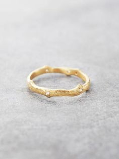 This artisan branch ring is organically textured with tiny thorn-like points, and set with the brightest sparkling Diamonds. Solid 18K Gold. Handcrafted with Love in NYC. Please allow 1-2 weeks. Diamo