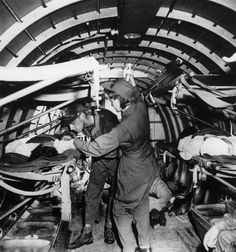 June 4, 1943: A wounded U.S. Marine is given a plasma transfusion by nurse Mae Olson aboard an aerial evacuation unit, over Guadalcanal, Solomon Islands.   [Army flight nurse Mae OLSON was the first nurse to fly into Guadalcanal in March 1943] ~