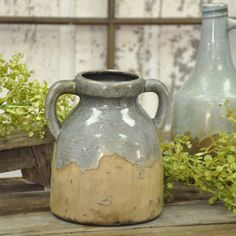 """Antique pottery and stoneware is hard to come by these days and that's why we loved this blue glaze crock. It has all the look of a fabulous find without the fabulous pricetag! The crackled blue glazing is worn through to the natural stoneware base which has just the right amount of """"aging"""". This is a perfect size for most of our faux greens, berry picks and flower bunches. 7""""H x 6""""W x 5.5""""D. #vintage #farmhouse #crock"""