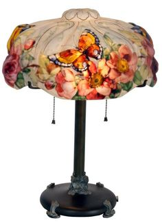 Pairpoint Puffy Papillon Table Lamp : puffy shade, reverse painted with colorful butterflies and 4 clusters of red roses with vines and leaves on a white background, decorated on the obverse with gilt outlines