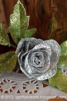 Aluminum foil roses!! These are beautiful!!!  Layer the foil,r take a thicker one,cut the circles, N hot glue .....that's it n u get beautiful roses....