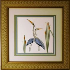 "Beautiful quilled Double Herons design is triple matted and framed in a 10"" x 10""  wood brown frame."