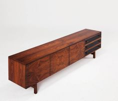 Long and impressive rosewood credenza | From a unique collection of antique and modern sideboards at http://www.1stdibs.com/furniture/storage-case-pieces/sideboards/