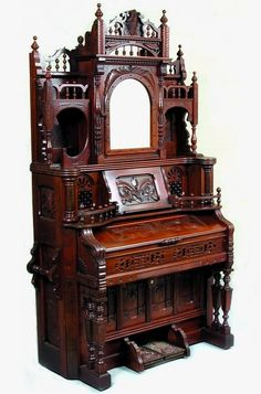 Love this beautiful, ornate Victorian walnut pump organ.  The detail is intricate and wonderful.