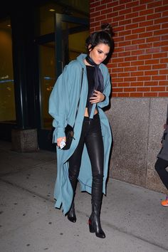 A pale blue Zimmermann trench coat, black t-shirt, leather leggings, and classic black boots.