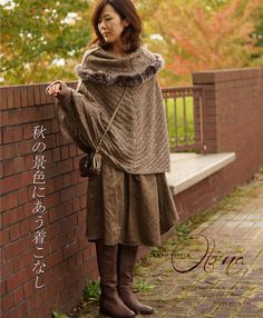 Here she is wearing the sweater backwards!!  Cute  that way too!!    Need to get an afghan to try this.  Cawaii