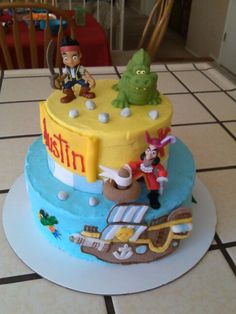 Jake and the neverland pirate cake made with bathy toys and figurines