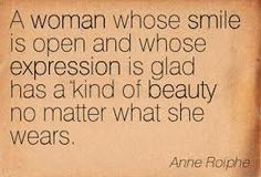 a woman whose smile is open and whose expression