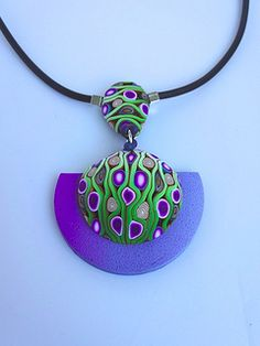 Purple and green polymer clay pendant Polymer Clay Canes, Polymer Clay Necklace, Polymer Clay Pendant, Fimo Clay, Polymer Clay Projects, Polymer Clay Creations, Polymer Clay Beads, Clay Earrings, Dangle Earrings