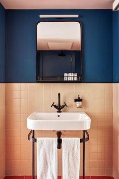 bathroom l pink tiles, navy wall