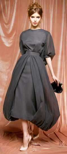 Ulyana Sergeenko...there is a lot of dress for a thin model, yet the dress is beautiful. I wonder if it's heavy?