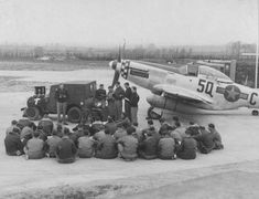 Crews gather round a 339th FG P-51D Mustang for a religious service (note the crucifix to the left of the jeep).