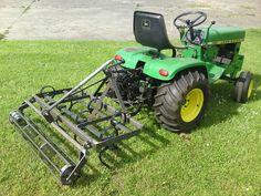 John Deere 140 with chisel plow. Homemade?
