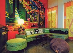 What fantastic use of color. The couch is the real star of this design.