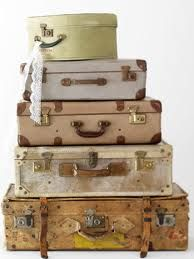 mores old suitcases. Double use as storage and table. Just add legs.