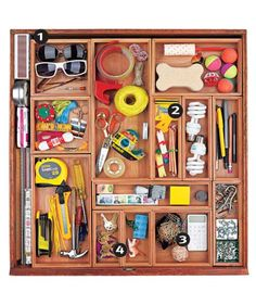 Group like items together in small trays to keep a junk drawer in order.